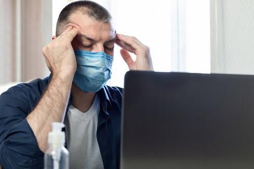 stressed man wearing mask